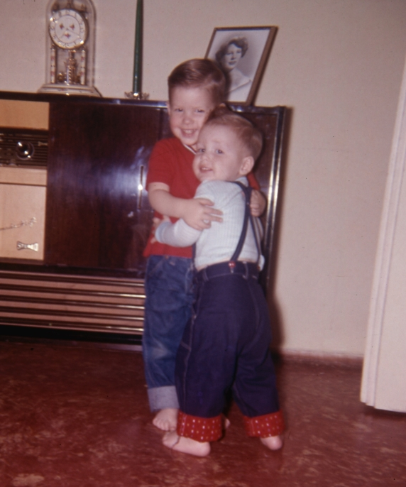 Les Hugging Greg