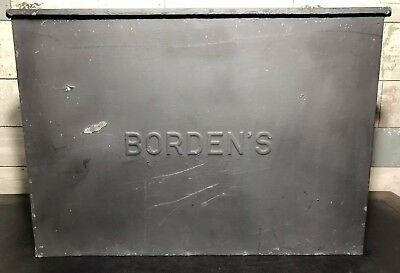 Vintage-Borden's-Embossed-Metal-Dairy-Farm-Milk-Bottle.jpg
